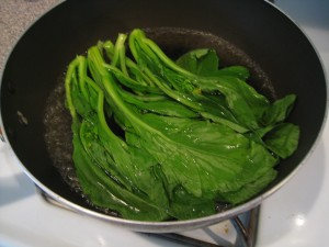 Cook Choy Sum in boiling water