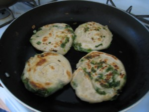 Pan fry the scallion pancakes
