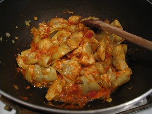Add pasta sauce to the artichokes