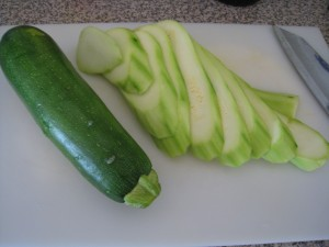 Peel and slice zucchini